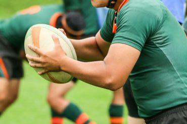 Das Rugby-Ei im Zeichen der olympischen Ringe